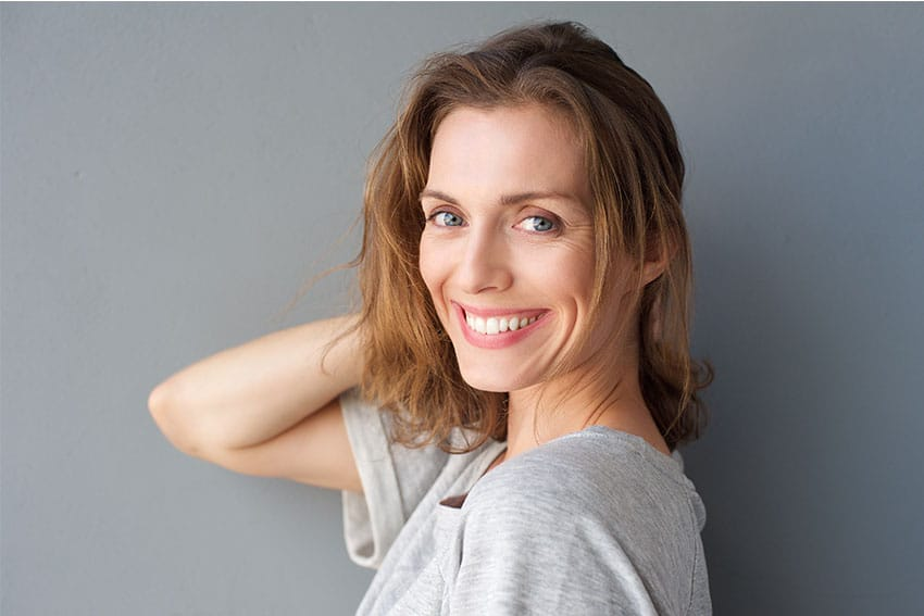 mature woman showing off her stunning smile